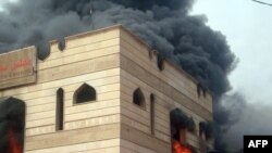Flames engulf the Wassit provincial council building in the southern city of Kut.