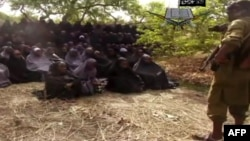 """Кадр из видеозаписи с изображением похищенных нигерийских школьниц, которую распространила """"Боко Харам"""""""