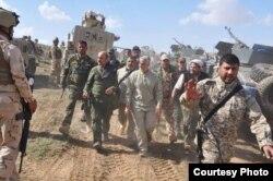 اشاره پایگاه دولت روحانی به «سایر نهادها یا چهرههای نظامی»، میتواند به سپاه پاسداران و شخص قاسم سلیمانی، فرمانده نیروی قدس، باشد که از زمان سقوط صدام حسین در سال ۲۰۰۳ نقش فعالی در عراق دارند.