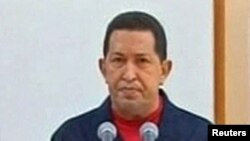 Venezuelan President Hugo Chavez addresses the nation during a televised speech broadcast on June 30.