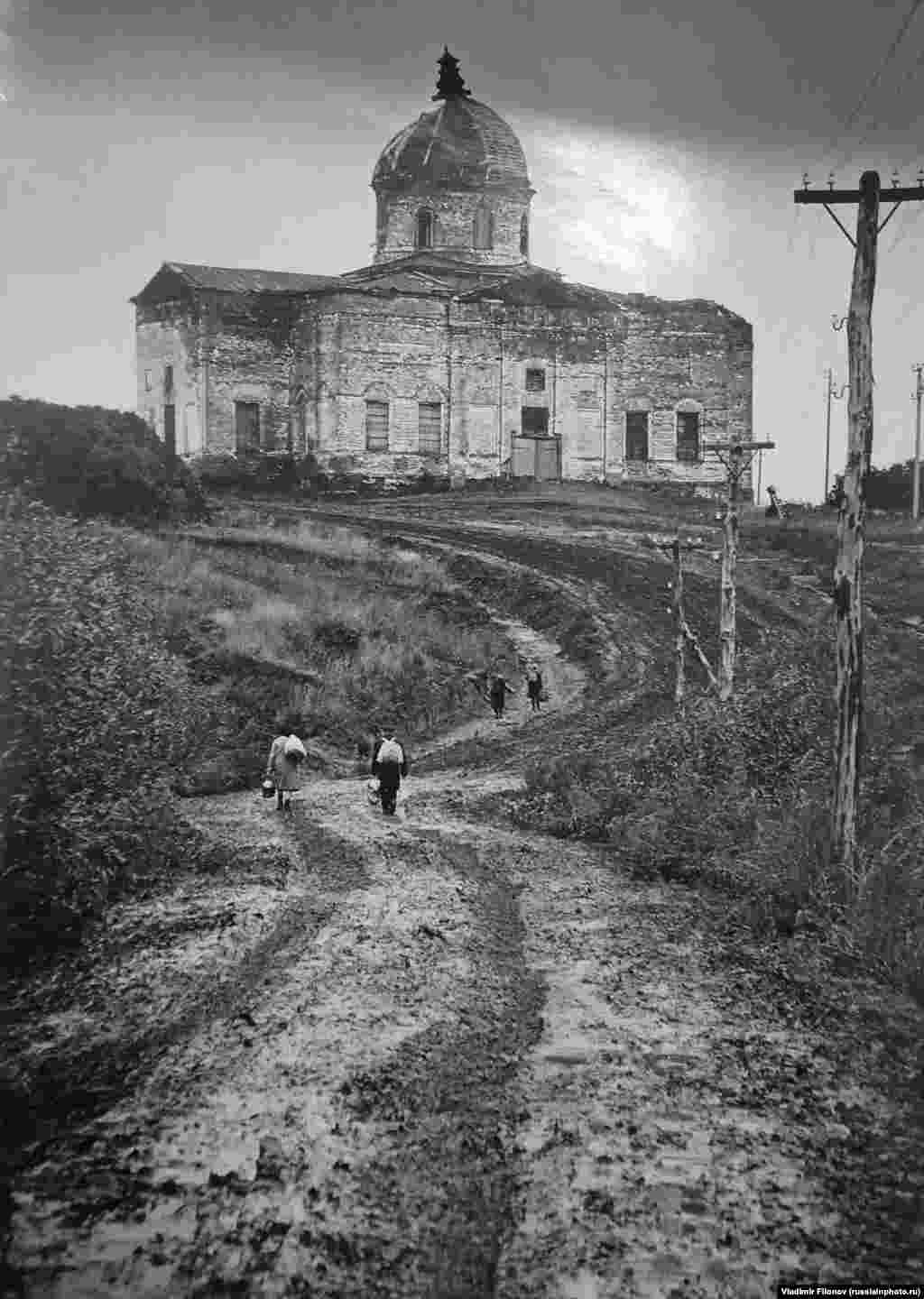 The road to a temple at an unidentified location in 1980. Official U.S.S.R. policy sought to do away with religion, and most churches were left to decay through the decades of Soviet rule.