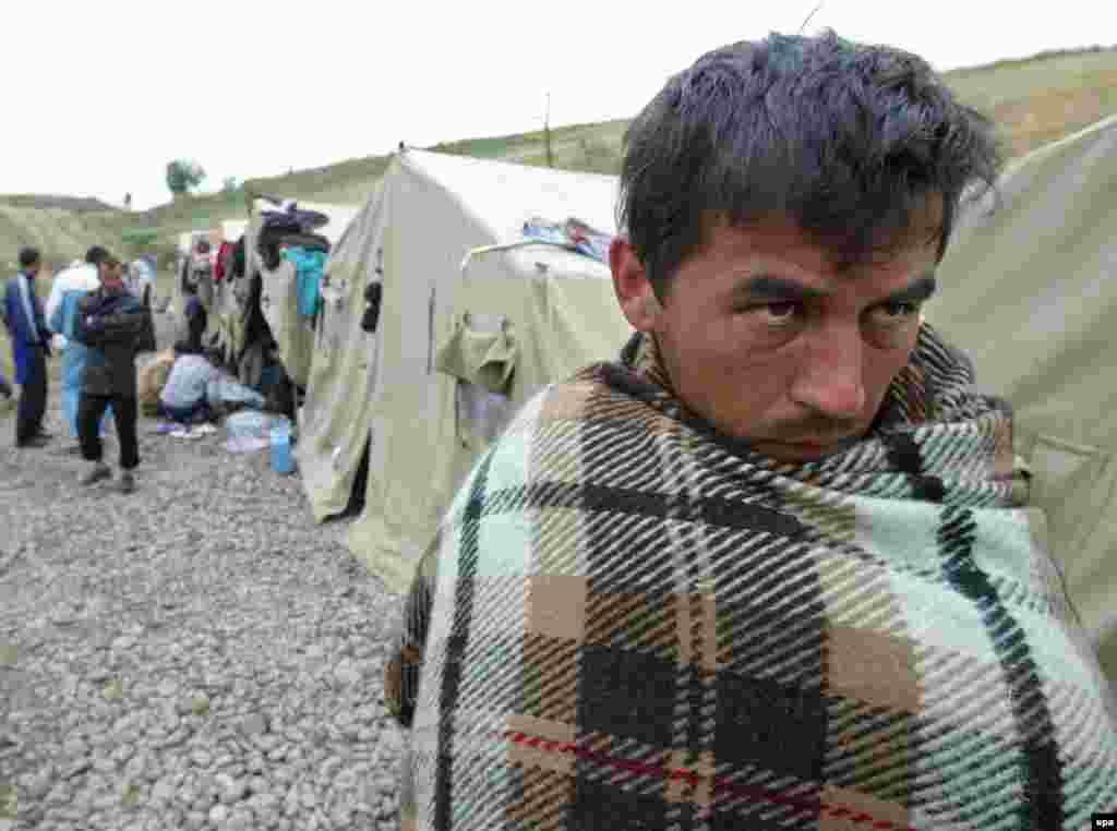 An Uzbek refugee at a camp near the Kyrgyz border village of Barash - Hundreds of Uzbeks fled Andijon for neighboring Kyrgyzstan in the days after the violence. Kyrgyzstan initially closed its border to stop the influx, sparking further protests and unrest. The United Nations High Commissioner for Refugees (UNHCR) eventually granted the fleeing Uzbeks refugee status and helped them relocate to third countries.