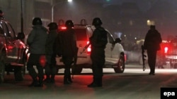 Members of the Afghan security services arrives an attack in Kabul near the Spanish Embassy in Kabul on December 11.