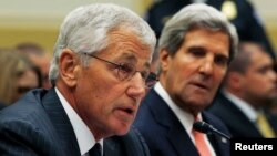 U.S. Secretary of Defense Chuck Hagel (left) testifies alongside Secretary of State John Kerry at a U.S. House Foreign Affairs Committee hearing on Syria in Washington on September 4.