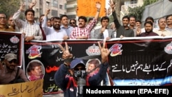FILE: Pakistani journalists shout slogans during a protest against the alleged killing of a journalist Aziz Memon in the southern city of Hayderabad in February