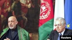 Церемония подписания соглашений о сотрудничестве между президентом Афганистана Хамидом Карзаем и премьер-министром Италии Мариол Монти в Риме