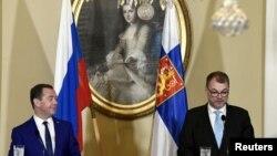 Юха Сипиля (справа) с российским премьером Дмитрием Медведевым, Хельсинки, 26 сентября 2018
