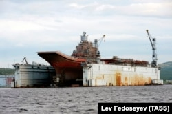 A file photo of the Admiral Kuznetsov aircraft carrier at the PD-50 dry dock in the village of Roslyakovo.