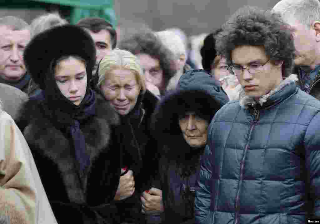 Nemtsov's former partner, Yekaterina Odintsova (second from left), their children Anton (right) and Dina, and Nemtsov's mother, Dina Eidman (second from right), attend the funeral.