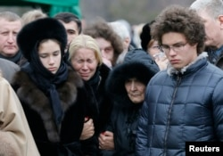 Nemtsov's former partner, Yekaterina Odintsova (second from left), their children Anton (right) and Dina, and Nemtsov's mother, Dina Eidman, attend his funeral in Moscow on March 3.