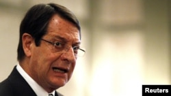 Cypriot President Nicos Anastasiades addresses a conference of civil servants in Nicosia on March 29.