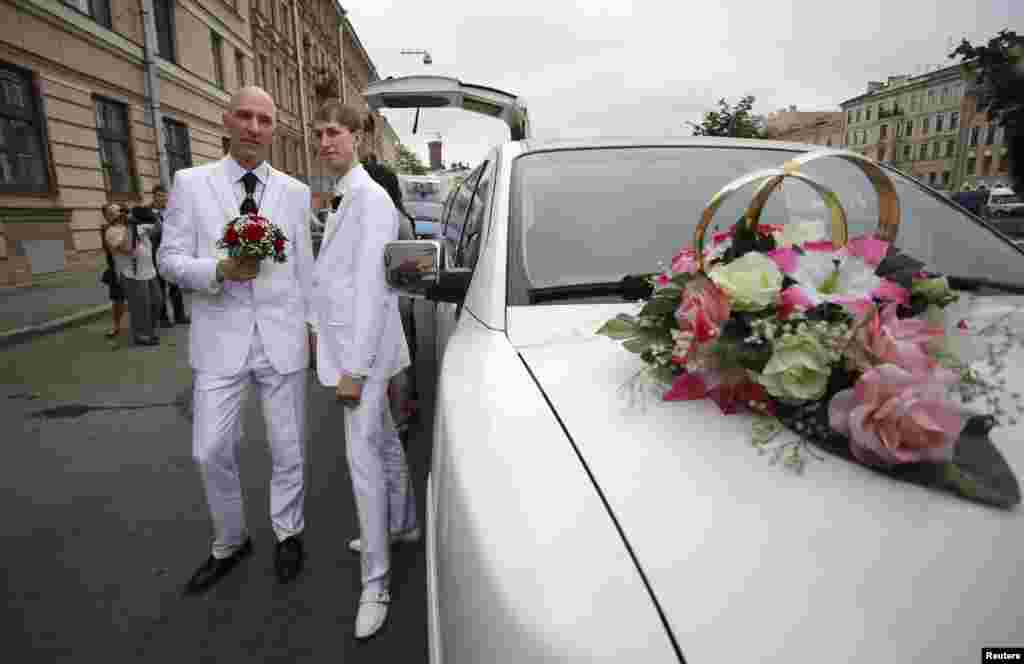 Same-sex couple Yury Gavrikov (left) and Maksim Lysak pose for a picture as they arrive at a registry office to apply for a marriage licence in St. Petersburg, Russia. Their application was not accepted. (Reuters/Artur Bainozarov)