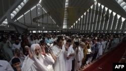 Pakistani Muslims offer first Friday Prayers during the Muslim fasting month of Ramadan at the Grand Faisal Mosque in Islamabad. (AFP/Aamir Qureshi)