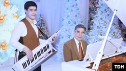 Gurbanguly Berdymukhammedov (right) and his grandson fiddle in the New Year.