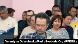 Андрій Ожаровський, на цьому архівному фото 12 травня 2011 року – на громадських слуханнях в Острозі на Рівненщині про добудову Хмельницької АЕС