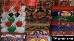 Қытай қазақтарының жиюлы тұрған көрпе-жастығы