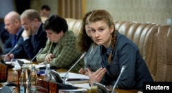 Butina (right) gained a name for herself in Russia in 2012 as she sought to build a Russian equivalent of the National Rifle Association.