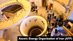 The waivers allowed European, Chinese, and Russian companies to work on the conversion of a heavy-water reactor in Arak, in western Iran.