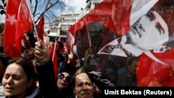 Supporters of the main opposition Republican People's Party wave portraits of Mustafa Kemal Ataturk. File photo