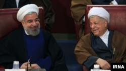 Iranian President Hassan Rohani (left) and former President Ali Akbar Hashemi Rafsanjani have called the insinuation an insult to voters' intelligence.
