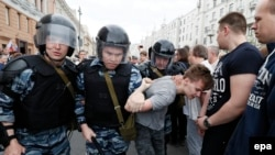 Russia – Russian police officers detain a participant of an unauthorized opposition rally in Tverskaya street in central Moscow, Russia, on Russia Day, 12 June 2017