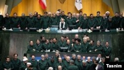 Iranian lawmakers in the April 9 parliament session wearing IRGC uniforms to show support for the military after it was listed the previous day as a terrorist outfit by the U.S.