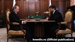 Russian President Vladimir Putin talking to Chechen leader Ramzan Kadyrov on March 25 in the Kremlin.