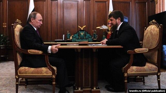 Russian President Vladimir Putin talking to Chechen leader Ramzan Kadyrov on March 25 in the Kremlin.