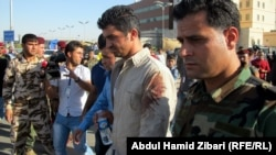 Members of the Asayish security services following a terrorist attack on their headquarters in Irbil