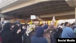 Demonstrators gather in front of Tehran's Evin Prison to demand information on family members.
