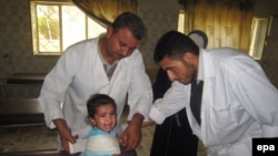 Iraqi doctors treat a child wounded by a roadside bomb.