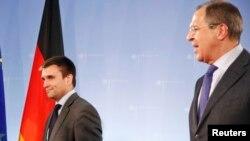 Министр иностранных дел Украины (слева) Павел Климкин и министр иностранных дел России Сергей Лавров после встречи в Берлине, 2 июля 2014 года.