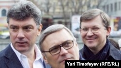 Former Deputy Prime Minister Boris Nemtsov and former Prime Minister Mikhail Kasyanov with ally Vladimir Ryzhkov (left to right) at a rally in Moscow in April