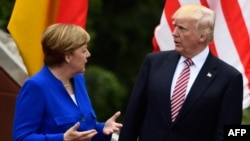 German Chancellor Angela Merkel (left) and U.S. President Donald Trump talk at the G7 summit in May.