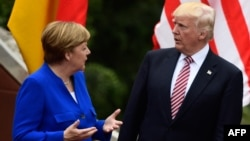 German Chancellor Angela Merkel (left) talks with U.S. President Donald Trump at the G7 summit in Taormina, Italy, on May 26.