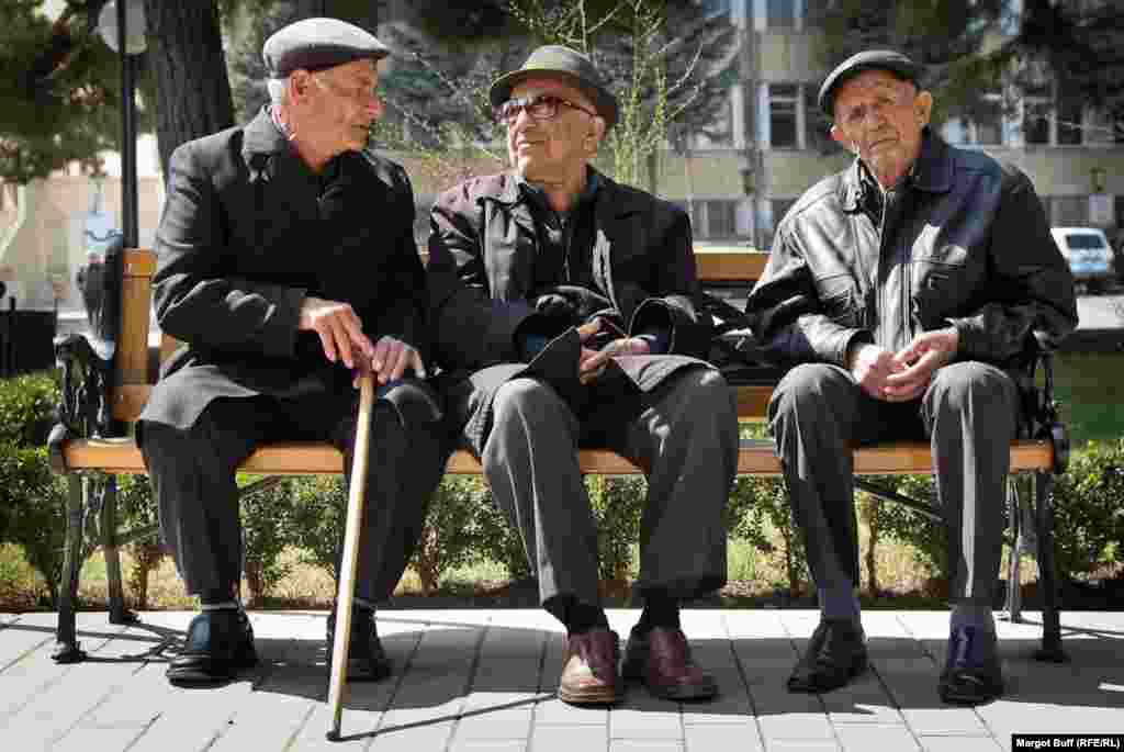 Men sit in a park in Stepanakert, the capital of Nagorno-Karabakh.