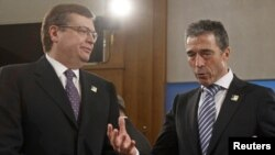 NATO Secretary-General Anders Fogh Rasmussen (right) talks to Ukraine's Foreign Minister Kostyantyn Hryshchenko during the meeting in Berlin on April 15.