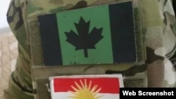Patches of a variation on the Canadian flag (above) and the Peshmerga flag on the camouflages of a Canadian fighting against Islamic State forces in Syria (undated)
