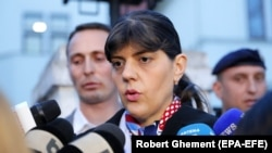 Laura Koevesi speaks to reporters in Bucharest on March 7.