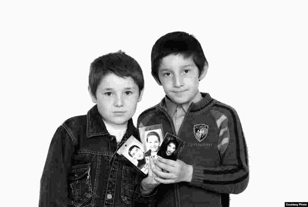 Timur (left) and Khetag Tamayev - These two brothers became orphans. Their entire family -- father, mother, and an older brother -- were killed in the siege. Eight-year-old Timur and 9-year-old Khetag remember only a little about them. Since they were small, their parents, Artur and Inga, left them at home with relatives on September 1, 2004. Their brother, Totraz, was starting first grade. Artur was killed during the first day of the siege. Inga and Totraz died on the last day. Timur and Khetag are being raised by their paternal grandmother.