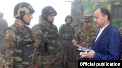 Armenia - Defense Minister Seyran Ohanian (R) awards soldiers on frontline duty.