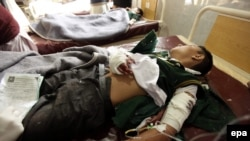 A school boy who was injured in a Taliban attack receives medical treatment at a hospital in Peshawar on December 16.