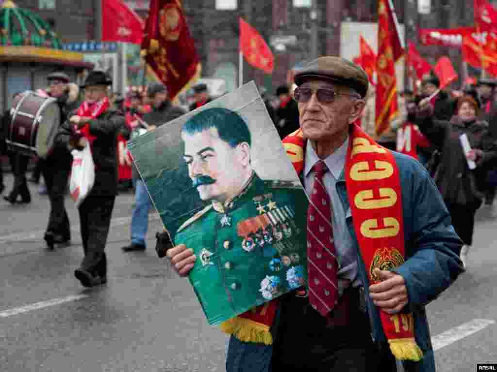In Moscow, communists march to mark the anniversary of the 1917 Bolshevik Revolution.