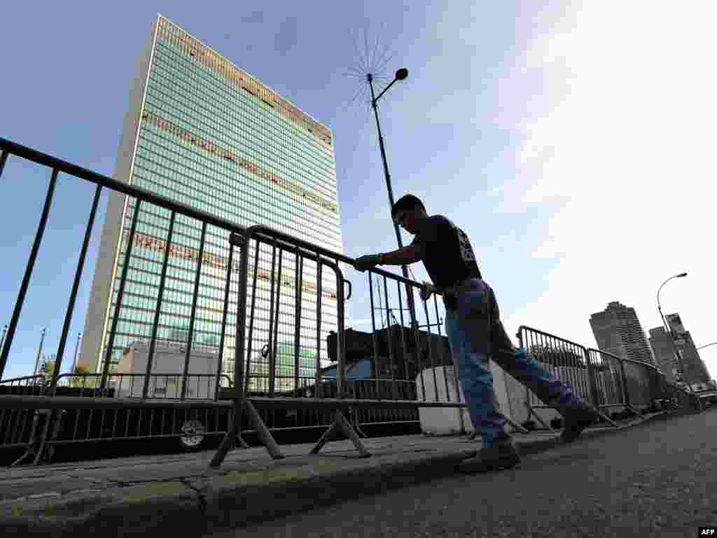 A policeman arranges barricades around the UN building in New York ahead of the 64th UN General Assembly.