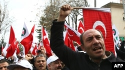 Members of a pro-government labor union demonstrate outside the French Embassy in Ankara over the proposed French law.