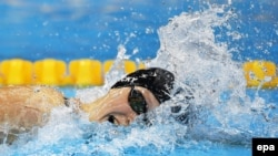 American swimming phenom Katie Ledecky soared into Olympic history, matching a 48-year record for winning freestyle events.