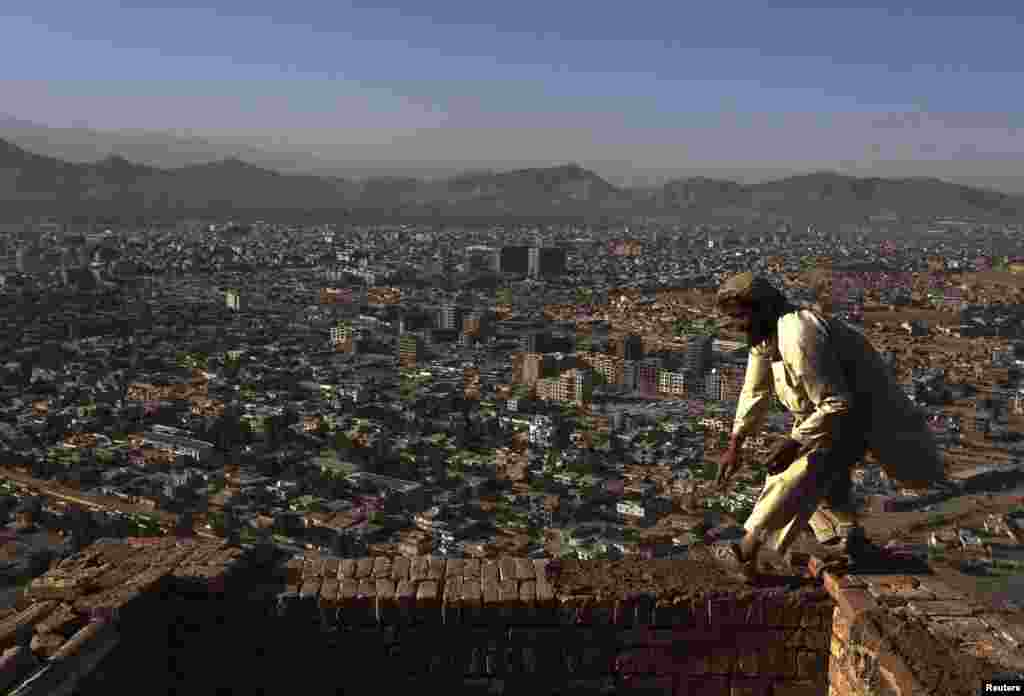 A man works at a construction site at a hilltop in Kabul. (Reuters/Omar Sobhani)