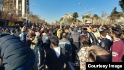Iranians take to the streets of Mashhad on December 29 in one of several demonstrations in the country against increasingly high prices and other economic woes.