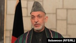 """""""The existence of corruption in Afghanistan is a reality; indeed, it is a bitter reality,"""" said Afghan President Hamid Karzai. (file photo)"""