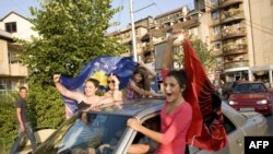 Kosovar Albanians celebrate the court ruling in the divided town of Mitrovica in northern Kosovo.